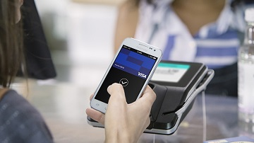 Using Visa Mobile Pay at a contactless-enabled terminal.